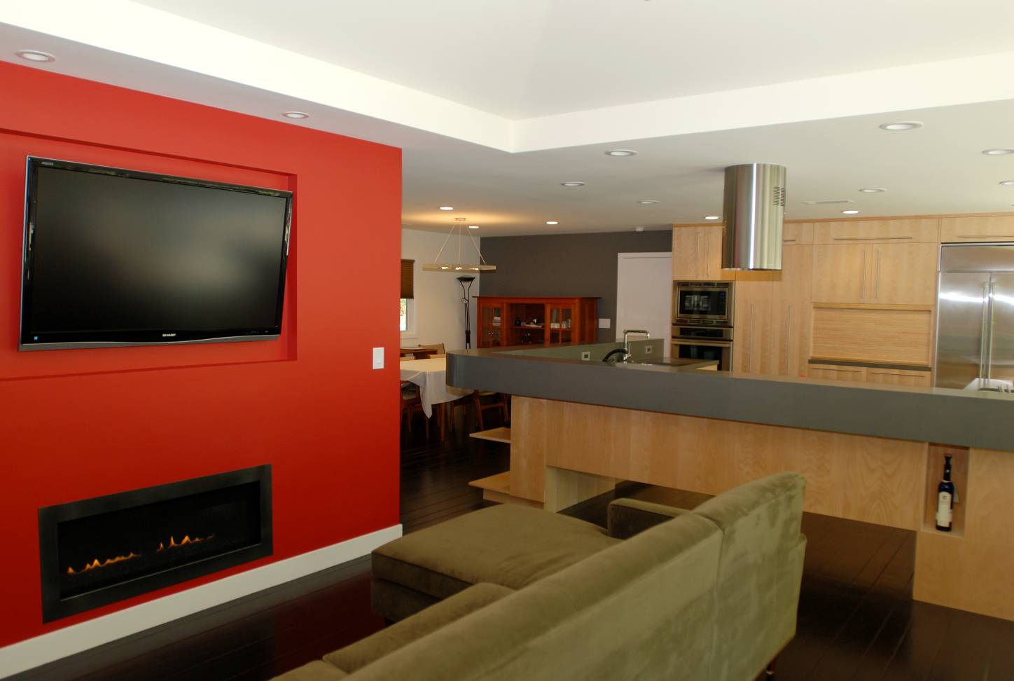Living room with fireplace red wall and kitchen view, Splendid Architect design, interior design work, Menlo Park