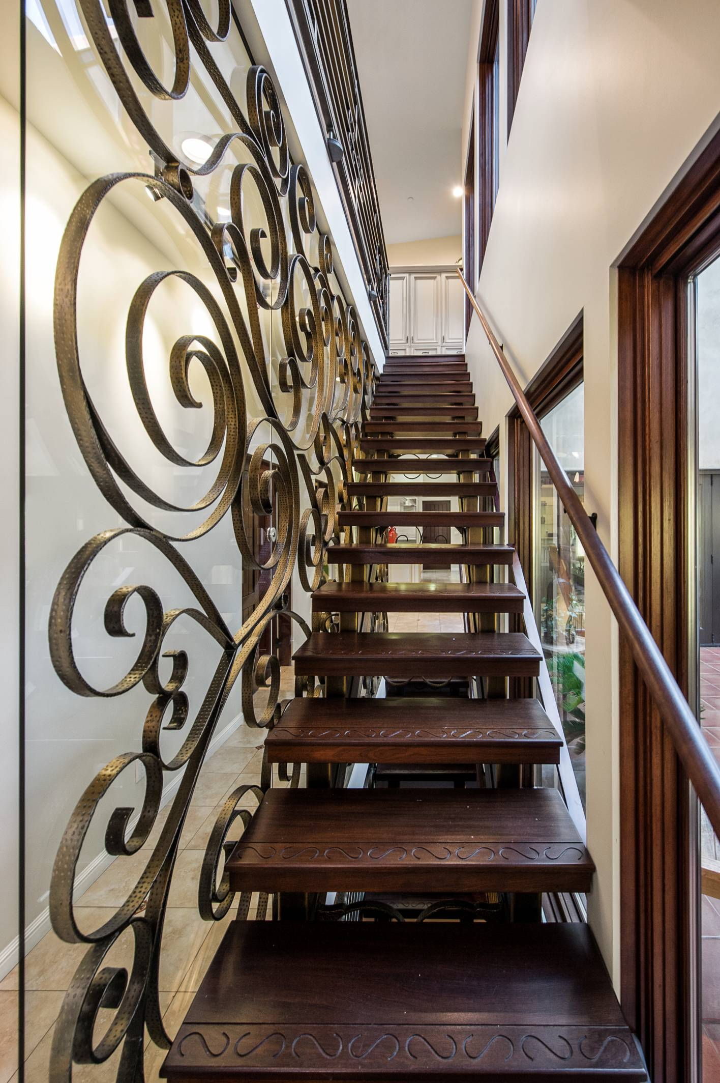 Wood steps staircase with copper handrail, interior work design, Los Altos
