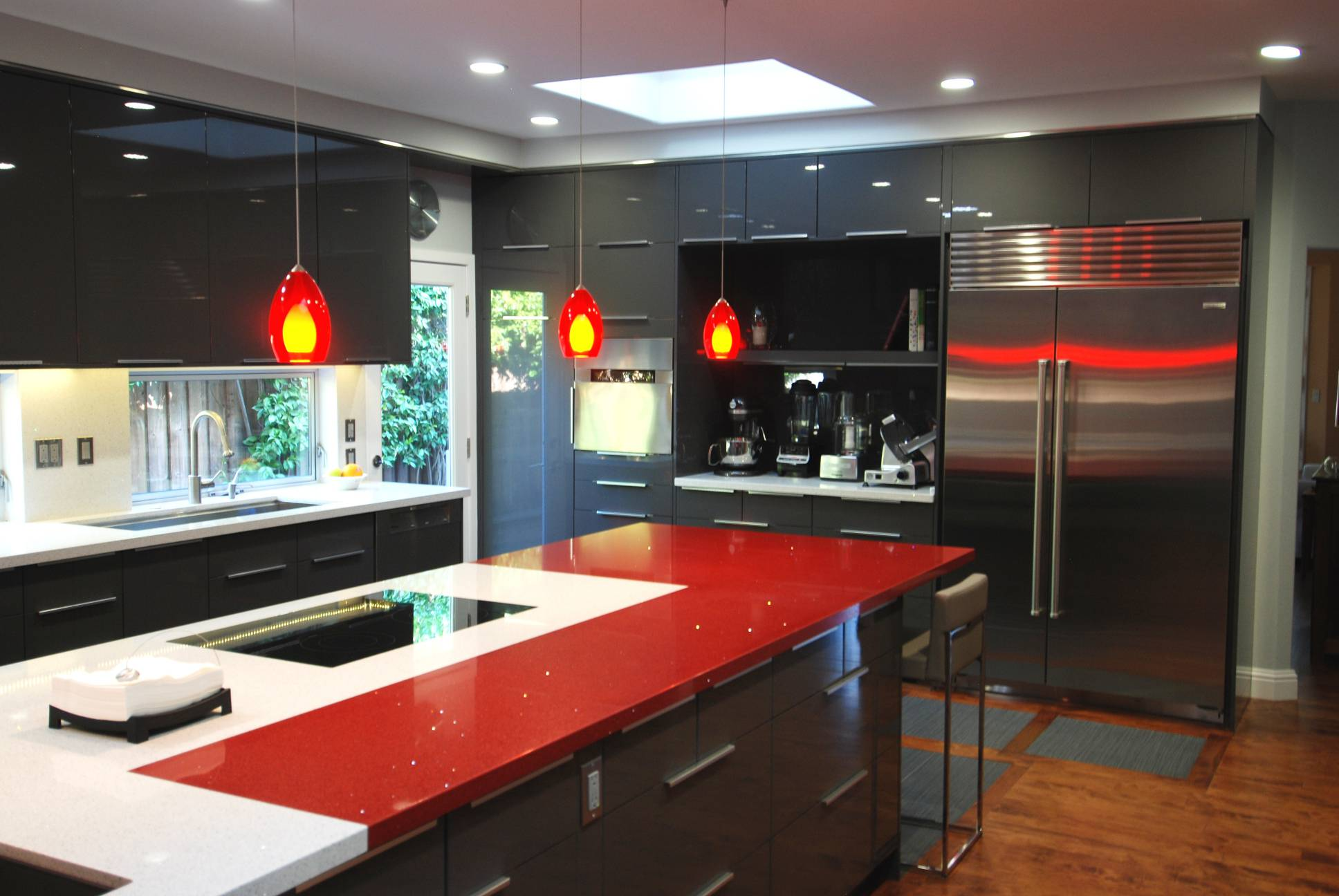 Modern kitchen red grey countertops cabinetry hanging lamps, best interior design, Los Altos