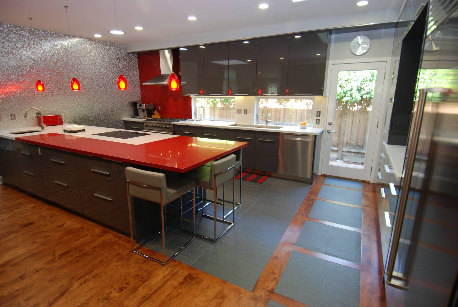 Modern kitchen red grey countertops cabinetry hanging lamps, interior design, Los Altos