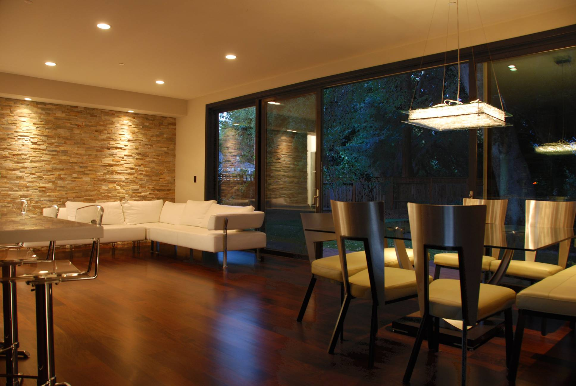 Modern sitting and dining area, stone wall, interior design, best architect work, Los Altos