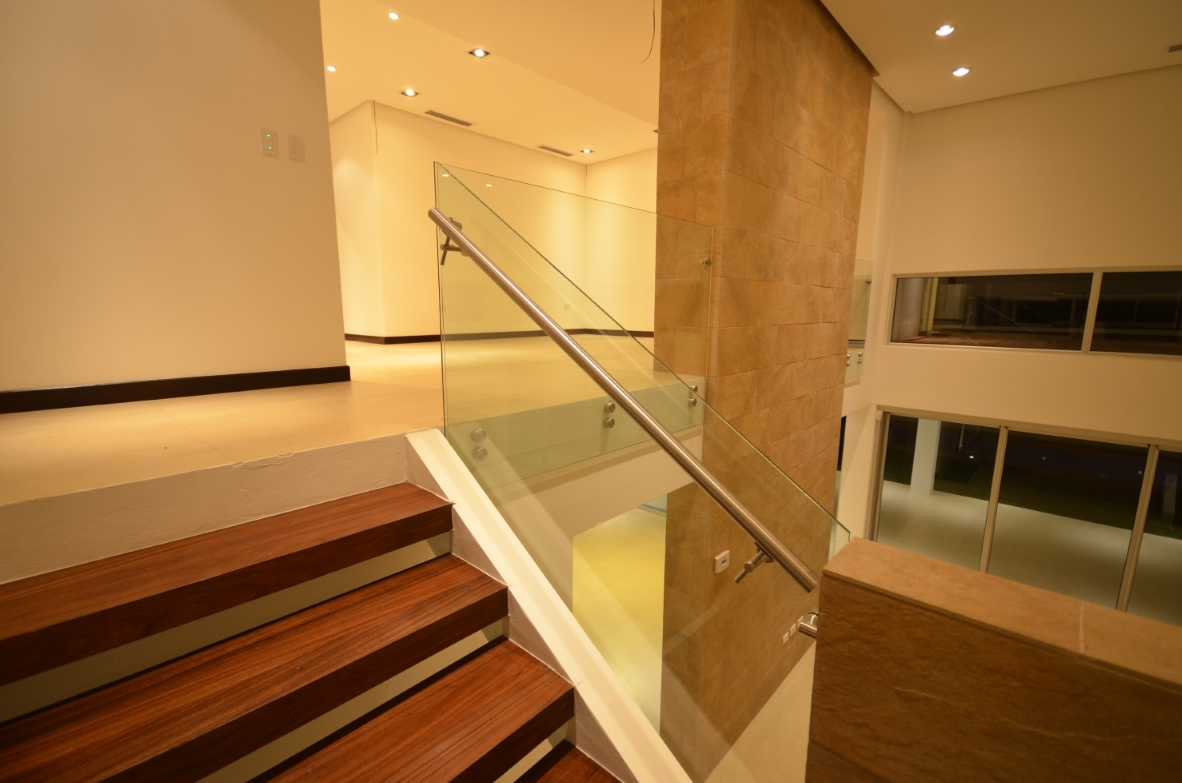 Mirror grill, wooden stairs, interior design Vitruvian Residence